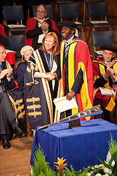 © Licensed to London News Pictures. 13/07/2012. Bolton , UK . Bolton University chancellor Baroness Morris of Bolton OBE kisses and shakes hands with footballer Fabrice Muamba who the University is awarding an honorary degree in recognition of the medical professionals who saved his life . Photo credit : Joel Goodman/LNP
