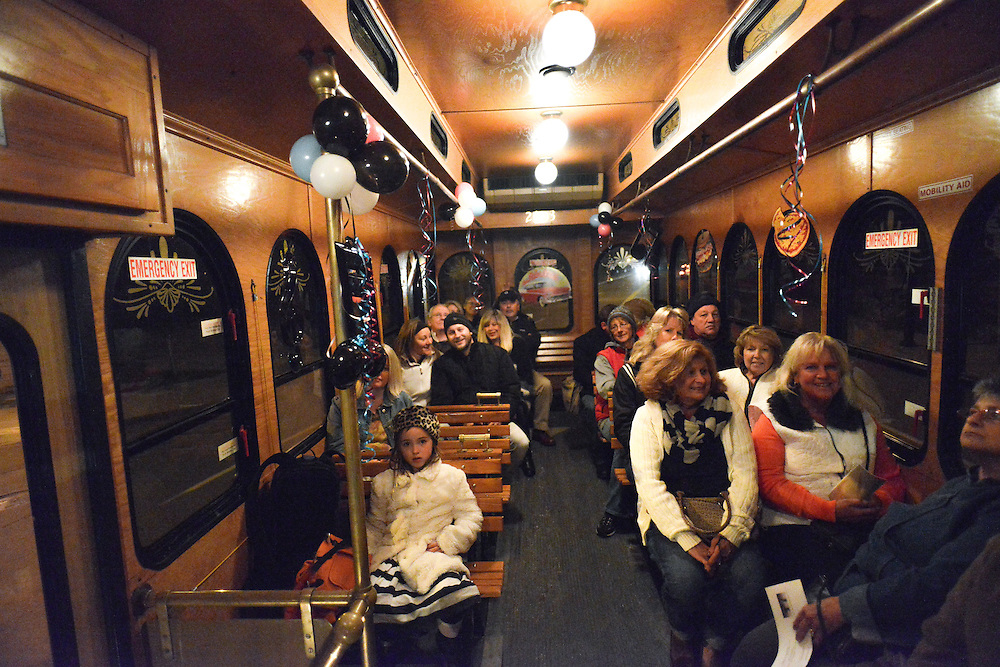 Guests riding in the Akron Trolley during Akron Art Prize 2014.