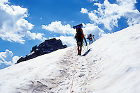 Mountaineers climbing near the top of the Inner Glacier on Mount Rainier, Washington, USA.