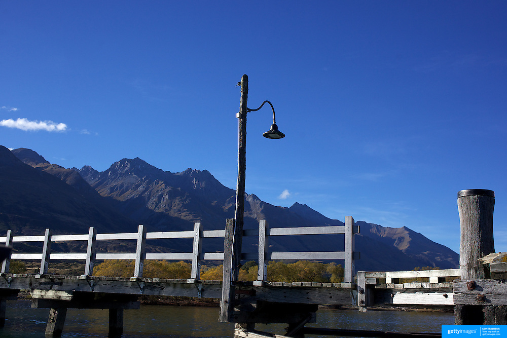 The Pier at Glenorchy in autumn..Glenorchy is a small settlement nestled in spectacular scenery at the northern end of Lake Wakatipu in New Zealand's south Island. It is approximately 45 kilometres by road or boat from Queenstown, the nearest large town..Glenorchy is a popular tourist spot, close to many tramping tracks. It lies near the borders of Mount Aspiring National Park and Fiordland National Park. The local scenery received worldwide attention when it was used as one of the settings in the first of Peter Jackson's Lord of the Rings films. Glenorchy is the home of  Dart River Jet Safaris. The  unique adventure combines exhilarating wilderness jet boating with unique Funyak inflatable canoes used to explore the magnificent World Heritage wilderness within Mt Aspiring National Park. Professional guides take participants through dramatic landscapes, paddling along channels of the glacier fed Dart River's braided river system as well as along hidden side streams, rock pools and dramatic chasms. Glenorchy, New Zealand. 13th April 2011. Photo Tim Clayton..
