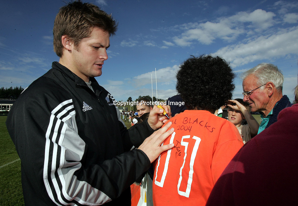 Richard McCaw signs autographs for fans during the All Blacks training session at Silverdale United RFC, North of Auckland, New Zealand, Wednesday 7th July 2004. The All Blacks play the Pacific Islanders on Saturday.<br />