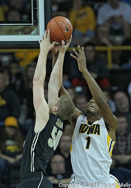 December 28, 2011: Purdue Boilermakers forward Travis Carroll (50) and Iowa Hawkeyes forward Melsahn Basabe (1) battle for a rebound during the NCAA basketball game between the Purdue Boilermakers and the Iowa Hawkeyes at Carver-Hawkeye Arena in Iowa City, Iowa on Wednesday, December 28, 2011. Purdue defeated Iowa 79-76.