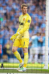 22.09.2013, Etihad Stadion, Manchester, ENG, Premier League, Manchester City vs Manchester United, 5. Runde, im Bild Manchester United's goalkeeper David de Gea looks dejected as Manchester City score the opening goal 22.09.2013, Etihad Stadion, Manchester, ENG, Premier League, Manchester City vs Manchester United, 5. Runde, im Bild. EXPA Pictures © 2013, PhotoCredit: EXPA/ Propagandaphoto/ David Rawcliffe<br /> <br /> ***** ATTENTION - OUT OF ENG, GBR, UK *****