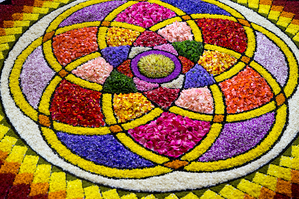 Thripunithura, INDIA - 2nd September 2019 - Pookalam competition on Athachamayam day in Thripunithura. Pookalam or Rangoli is one of the most popular traditional art forms in India. It is a kind of decorative motif, usually a floor art using various forms of colours from flowers and other colourful natural objects like spices and grains to create a decorative carpet of flowers. It is an integral part of Onam festival celebrations in Kerala. Ernakulam District of Kochi (Cochin), Kerala, Southern India.