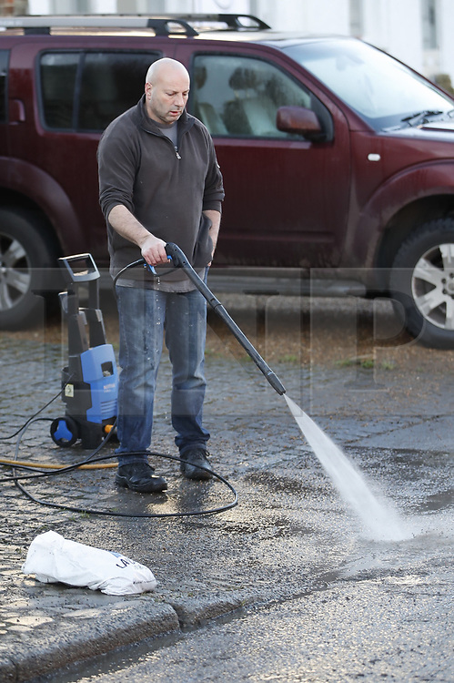 © Licensed to London News Pictures. 23/12/2019. Yalding, UK. A resident uses a power washer to clean up in Yalding, Kent after flood levels begin to recede in the centre of the village. River levels are beginning to drop after days of heavy rain in the south. Photo credit: Peter Macdiarmid/LNP