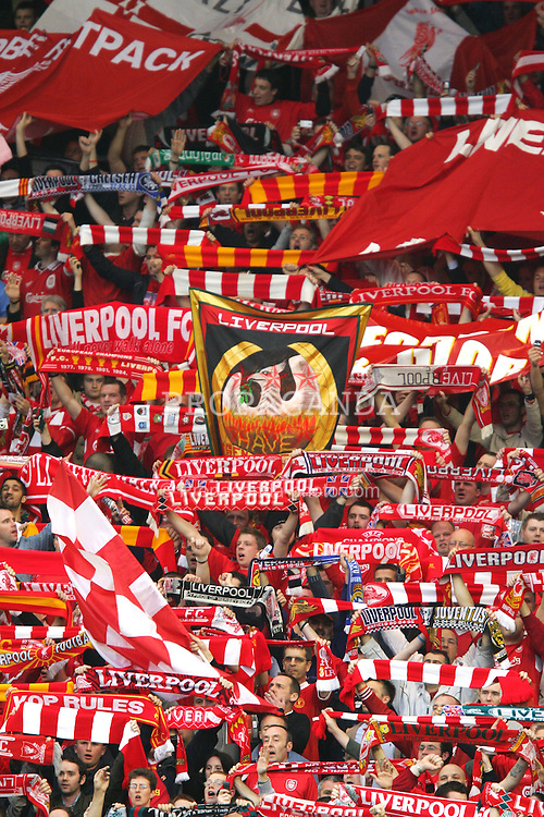 """LIVERPOOL, ENGLAND. TUESDAY, MAY 3rd, 2005: Liverpool supporters on the Spion Kop sing """"You'll never walk alone"""" before before the UEFA Champions League Semi Final 2nd Leg against Chelsea at Anfield. (Pic by David Rawcliffe/Propaganda)"""