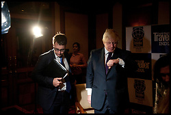 Mayor of London Boris Johnson with his Private Secretary Ben Gascoigne  checks his watch after being interviewed by the bbc in hotel in Mumbai, Wednesday November 28, 2012. Photo by Andrew Parsons / i-Images