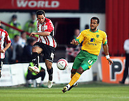 London - Tuesday, August 18th, 2009: Sam Wood of Brentford and Simon Whaley of Norwich City during the Coca Cola League One match at Griffin Park, London. (Pic by Chris Ratcliffe/Focus Images)