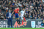 England Forward Theo Walcott wins the header in front of England Caretaker Manager Gareth Southgate during the International Friendly match between England and Spain at Wembley Stadium, London, England on 15 November 2016. Photo by Mark Davies.