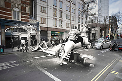 © Licensed to London News Pictures. 25/03/2020. London, UK. In this combined image a mounted police officer jumps his horse over a barricade on Upper St Martin's Lane during the London poll tax riots on March 31st 1990 overlaid on the same location today. The protest on the last day of March in 1990 started peacefully when thousands gathered in a south London park to demonstrate against Margaret Thatcher's Government's introduction of the Community Charge - commonly known as the poll tax. Marchers walked to Whitehall and Trafalgar Square where violence broke out with the trouble spreading up through Charring Cross Road and on to the West End. Police estimated that 200,000 people had joined the protest and 339 were arrested. The hated tax was eventually replaced by the Council Tax under John Major's government in 1992.  Photo credit: Peter Macdiarmid/LNP