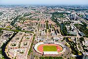 Nederland, Noord-Holland, Amsterdam-Zuid, 29-06-2018; Stadionbuurt met Olympisch stadion, nieuwbouw op het Stadionplein. In het verschiet van de Stadionweg de Apollobuurt, rechts Zuidas.<br /> Olympic Stadium and Stadium neighborhood.<br /> <br /> luchtfoto (toeslag op standard tarieven);<br /> aerial photo (additional fee required);<br /> copyright foto/photo Siebe Swart