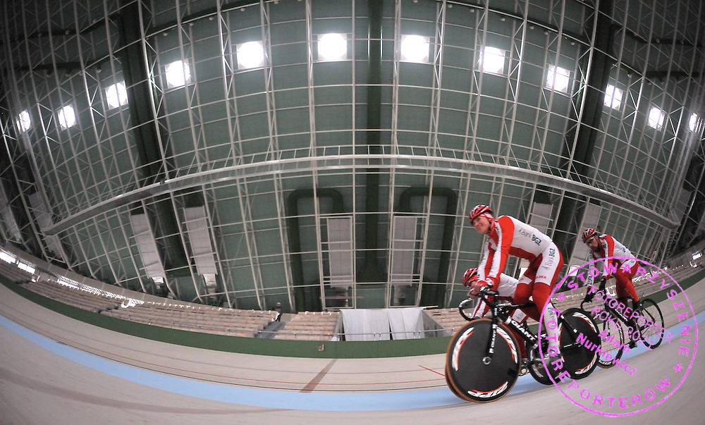 CYCLISTS DURING TECHNICAL TEST CYCLE TRACK ( VELODROME ) IN PRUSZKOW, POLAND..VELODROM IN PRUSZKOW IS DESIGNED BY WOJCIECH ZABLOCKI.PRUSZKOW , POLAND , MARCH 17, 2008.( PHOTO BY ADAM NURKIEWICZ / MEDIASPORT )