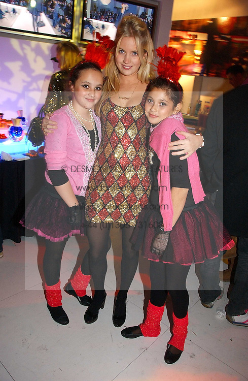Left to right, PHOEBE SAATCHI, MARISSA MONTGOMERY and SCARLETT LESLEY at a party to celebrate the launch of DKNY Kids and Halloween in aid of CLIC Sargent and RX Art held at DKNY, 27 Old Bond Street, London on 31st October 2006.<br />