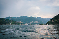 COMO, ITALY - 21 JUNE 2017: A view of Lake in Como, Italy, on June 21st 2017.<br /> <br /> Residents of Como are worried that funds redirected to migrants deprived the town's handicapped of services and complained that any protest prompted accusations of racism.<br /> <br /> Throughout Italy, run-off mayoral elections on Sunday will be considered bellwethers for upcoming national elections and immigration has again emerged as a burning issue.<br /> <br /> Italy has registered more than 70,000 migrants this year, 27 percent more than it did by this time in 2016, when a record 181,000 migrants arrived. Waves of migrants continue to make the perilous, and often fatal, crossing to southern Italy from Africa, South Asia and the Middle East, seeing Italy as the gateway to Europe.<br /> <br /> While migrants spoke of their appreciation of Italy's humanitarian efforts to save them from the Mediterranean Sea, they also expressed exhaustion with the country's intricate web of permits and papers and European rules that required them to stay in the country that first documented them.