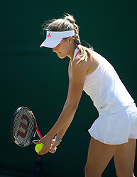 LONDON, ENGLAND - Monday, June 27, 2011: Eugenie Bouchard (CAN) in action during the Girls' Singles 1st Round match on day seven of the Wimbledon Lawn Tennis Championships at the All England Lawn Tennis and Croquet Club. (Pic by David Rawcliffe/Propaganda)