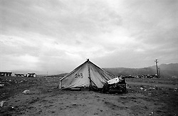 A lonely tent on the outskirts of Konik camp, a refugee camp for romany gypsies who had to feel Kosvo. ..Konik camp - a refugee camp for Roma (gypsies) displaced from Kosovo, Montenegro