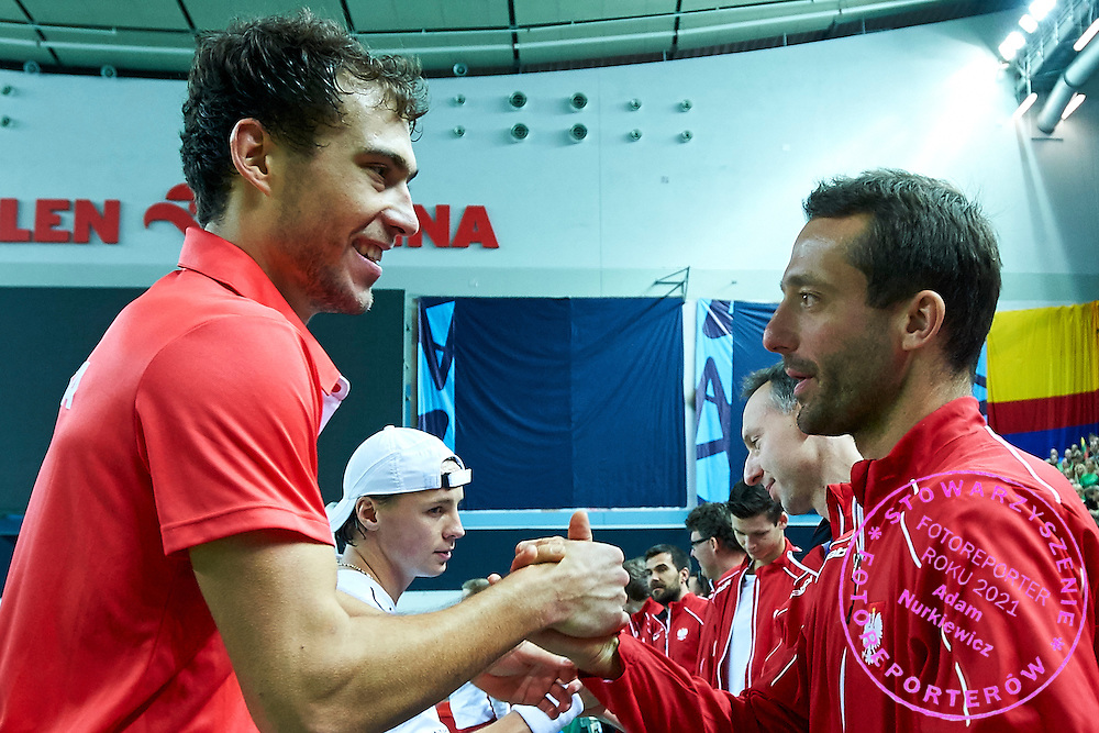 (L) Jerzy Janowicz and (R) trainer assistant Aleksander Charpantidis of Poland celebrate winning point and winning game and victory the match during third day the Davies Cup / Group I Europe / Africa 1st round tennis match between Poland and Lithuania at Orlen Arena on March 8, 2015 in Plock, Poland<br /> Poland, Plock, March 8, 2015<br /> <br /> Picture also available in RAW (NEF) or TIFF format on special request.<br /> <br /> For editorial use only. Any commercial or promotional use requires permission.<br /> <br /> Mandatory credit:<br /> Photo by &copy; Adam Nurkiewicz / Mediasport