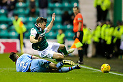 Cammy Kerr (#2) of Dundee slides in to win the ball against Lewis Stevenson (#16) of Hibernian during the Ladbrokes Scottish Premiership match between Hibernian and Dundee at Easter Road, Edinburgh, Scotland on 24 November 2018.