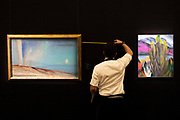 UNITED KINGDOM, London: 09 April 2018 Final measurements to Georgia O'Keeffe's 'Lake George with White Birch' 1921 (right) estimated at $4-6 Million at the Impressionist and Modern and Contemporary Art preview at Sotheby's. The Impressionist and Modern art sale will be held in New York on 14th May. Sotheby's Impressionist and Modern Art Sale, London, UK- 9 Apr 2018 Rick Findler / Story Picture Agency