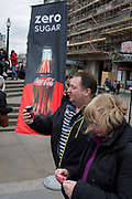 A passer-by tastes a sample of the new Zero Sugar (Sugar Free) Coca-Cola drinks, given out in Piccadilly Circus, on 16th April 2018, in London, England.