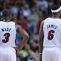 17 November 2010: Miami Heat's shooting guard #3 Dwyane Wade rests next to Miami Heat's small forward #6 LeBron James during the Miami Heat 123-96 victory over the Phoenix Suns at the AmericanAirlines Arena, Miami, Florida, USA.