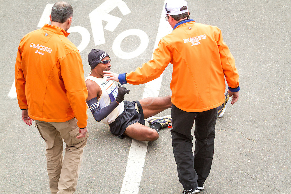 ING New York CIty Marathon: Meb Keflezighi, USA, on ground after finishing race, signalling to race officials that he's alright