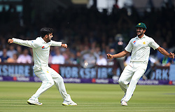 Pakistan's Shadab Khan (left) celebrates taking the wicket of England's Mark Stoneman during day three of the First NatWest Test Series match at Lord's, London.