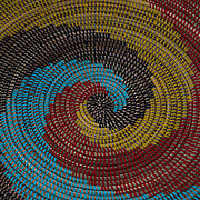 Design pattern of African hand woven basket from grass and palm leaf is a traditional craft of Zulu peoples in South Africa
