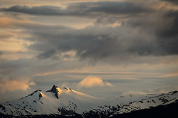An unnamed peak in Chilkat Range near Juneau is basked in the light of the sunset as seen from the Lynn Canal near Juneau, Alaska.