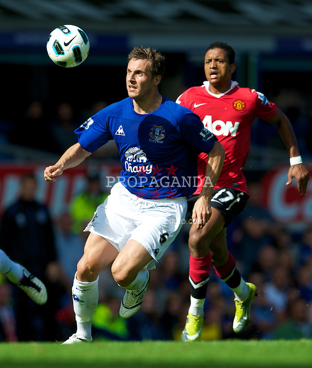LIVERPOOL, ENGLAND - Saturday, September 11, 2010: Everton's Phil Jagielka in action against Manchester United during the Premiership match at Goodison Park. (Photo by David Rawcliffe/Propaganda)