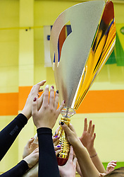 Players of Nova KBM celebrate with a trophy after the volleyball match between Nova KBM Branik Maribor and OK Luka Koper in Final of Women Slovenian Cup 2014/15, on January 18, 2015 in Sempeter v Savinjski dolini, Slovenia. Photo by Vid Ponikvar / Sportida