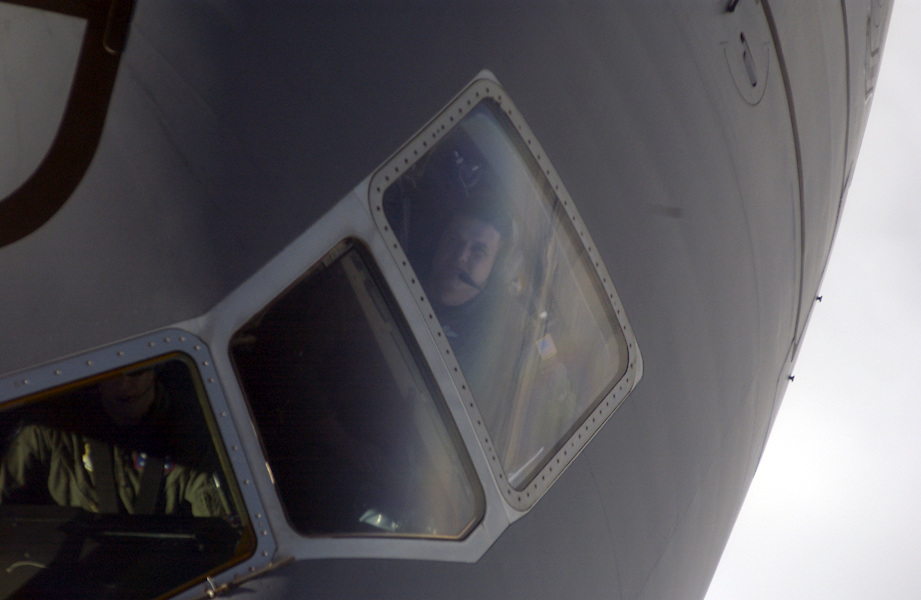 High above the clouds, Master Sgt. Mike Frazer, boom operator, peers up at another KC-10 Extender of the 379th Air Refueling Wing (reserve), Travis Air Force Base, CA during an air refueling training mission over the Nevada and Utah region of the United States. He is calling out to the pilot, the estimated distances between the aircrafts as they move forward into contact position with the refueling boom. (U.S. Air Force photo by Master Sgt. Lance Cheung)