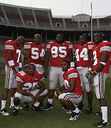 Ted Ginn Jr., left, and some of the Buckeyes pose for a personal photo.