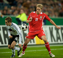 MONCHENGLADBACH, GERMANY - Wednesday, October 15, 2008: Wales' David Edwards and Germany's Philipp Lahm during the 2010 FIFA World Cup South Africa Qualifying Group 4 match at the Borussia-Park Stadium. (Photo by David Rawcliffe/Propaganda)
