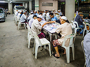 14 JUNE 2017 - BANGKOK, THAILAND: People eat the Iftar mean in the car park of Masjid Hidayatun Islam. Iftar is the evening meal when Muslims end their daily Ramadan fast at sunset. Iftar is a communal event at Masjid Hidayatun Islam and more than a hundred people usually attend the meal.      PHOTO BY JACK KURTZ