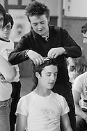 Getting a mohican haircut on the People's  March for Jobs, Yorkshire to London. Wakefield 04/05/1981