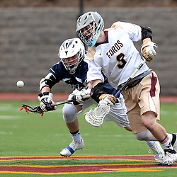 Staff photos by Tom Kelly IV<br /> Haverford's Jake Hervada (3) and Episcopal's Christian Feliziani (3) face off during the Episcopal Academy at the Haverford School boys lacrosse game on Tuesday, April 7, 2015.