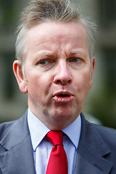 © Licensed to London News Pictures. 01/05/2015. LONDON, UK. Conservative Chief Whip Michael Gove highlights the possibility of the SNP propping up Labour leader Ed Miliband as Prime Minister at Victoria Tower Gardens, London on Friday, 1 May 2015. Photo credit : Tolga Akmen/LNP