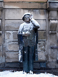 Statue of Evert Taube in Gamla Stan old town district in winter in Stockholm Sweden