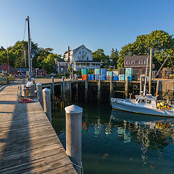 A lobster boat docked at Miller's Wharf, in front of the Tenants Harbor Fisherman's Coop in Tenants Harbor, Maine.