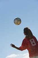 Teenage Girl Heading Soccer Ball