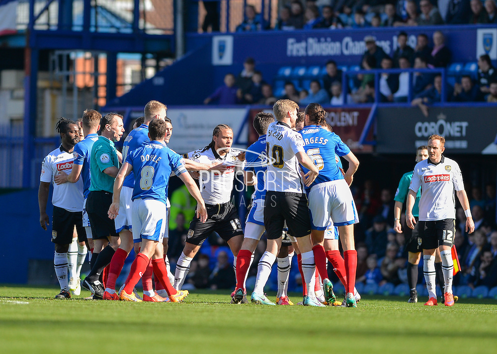 Portsmouth and Notts county players come together after a tackle by Notts County Midfielder Stanley Aborah during the Sky Bet League 2 match between Portsmouth and Notts County at Fratton Park, Portsmouth, England on 25 March 2016. Photo by Adam Rivers.