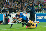 London, Great Britain,  Romanion, Florin SURUGIA, with a flying tackle on Sofiane GUITOUNE, as he moves in to score his first half try in the Pool D game.  France vs Romania. 2015 Rugby World Cup. Venue. The Stadium Queen Elizabeth Olympic Park. Stratford. East London. England,, Wednesday  23/09/2015. <br /> [Mandatory Credit; Peter Spurrier/Intersport-images]