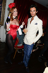 MARK-FRANCIS VANDELLI and Bunnygirl waitress at a private view of 'Psycho Nacirema' at Pace Gallery, 6-10 Lexington Street followed by a party at The Playboy Club, Old Park Lane, London on 5th June 2013.