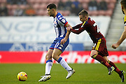 Ipswich's Freddie Sears (20) gets to grips with Wigan's Yanic Wildschut (31) during the EFL Sky Bet Championship match between Wigan Athletic and Ipswich Town at the DW Stadium, Wigan, England on 17 December 2016. Photo by Craig Galloway.