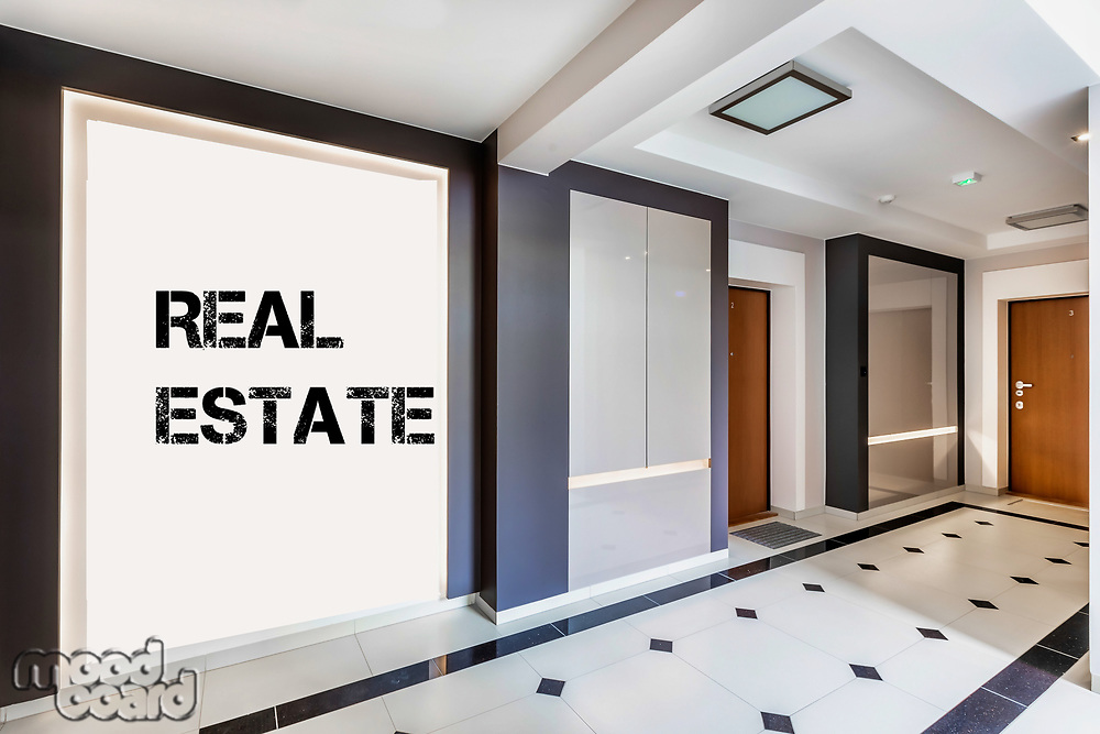 Photo of rental apartment business interior with real estate sign on the wall