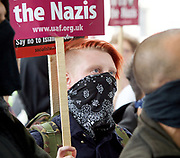 UAF supporter in counter demonstration <br /> <br /> <br /> English Defence League <br /> protest at Charing Cross with a counter Unite Against Fascism protest on Victoria Embankment <br /> 24th June 2017 <br /> <br /> General View and Metropolitan Police containing the march. <br /> <br /> Photograph by Elliott Franks <br /> Image licensed to Elliott Franks Photography Services