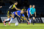 Rotherham United defender Michael Ihiekwe (20) fouls Gillingham FC forward Josh Parker (14) during the EFL Sky Bet League 1 match between Gillingham and Rotherham United at the MEMS Priestfield Stadium, Gillingham, England on 17 April 2018. Picture by Martin Cole.