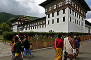 BU0001-00...BHUTAN - Tashichoedzong in the capital city of Thimphu, the center of government for the country. Locals and visitor head to the large courtyard to watch dancing and religious celebrations.