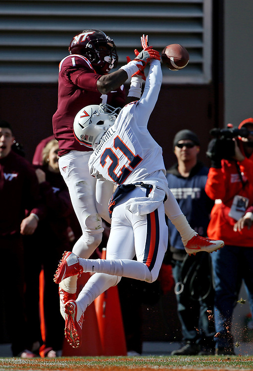 Nov 26, 2016; Blacksburg, VA, USA;  Virginia Cavaliers safety Juan Thornhill (21) breaks a up a pass to Virginia Tech Hokies wide receiver Isaiah Ford (1) during the second quarter at Lane Stadium. Mandatory Credit: Peter Casey-USA TODAY Sports